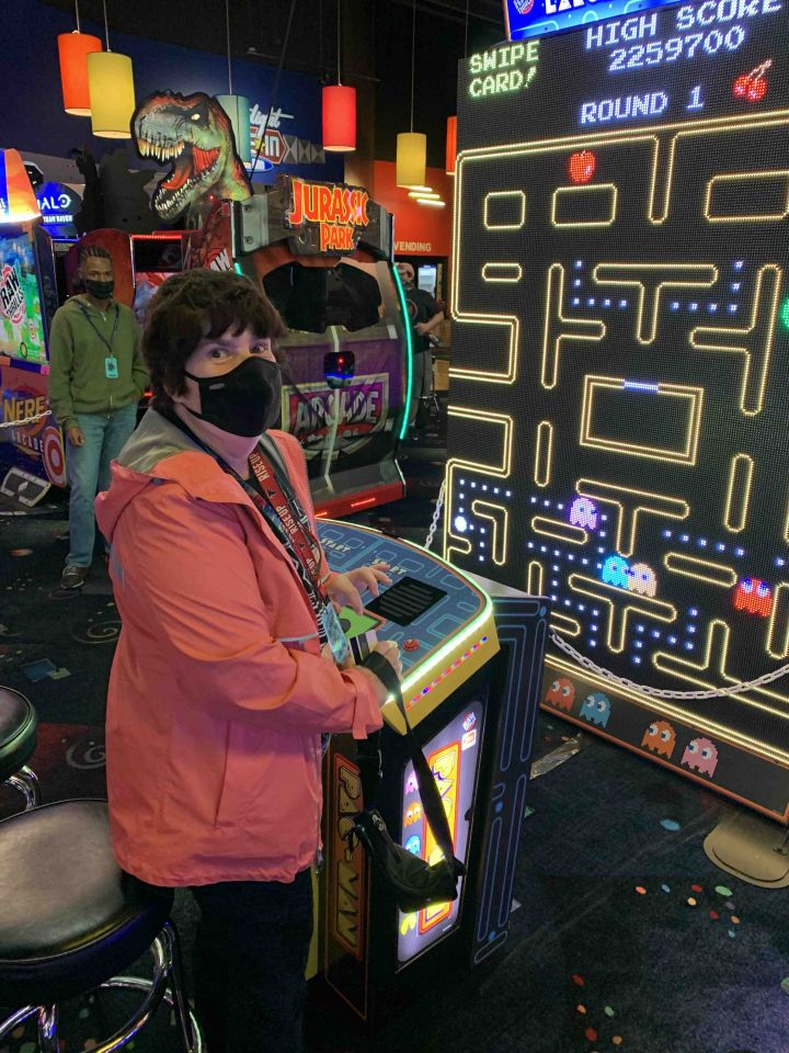 Member enjoying a game at Dave & Busters